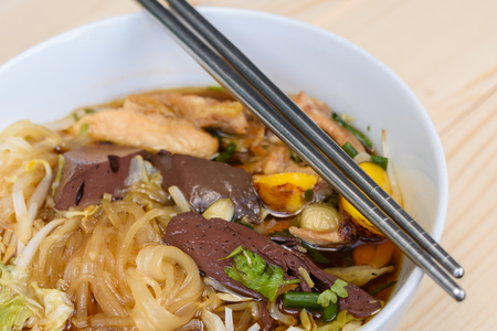 noodle soup: noodle soup with chopsticks in bowl on a wooden table, Thai local food