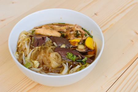 noodle soup: noodle soup in bowl on a wooden table, Thai local food