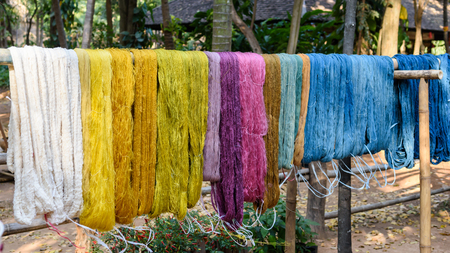 colorful thread raw silk cloth dye from natural color material for woven, handicraft thai style Stock Photo