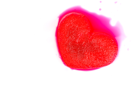 frozen red heart melting isolated on white background Stock Photo