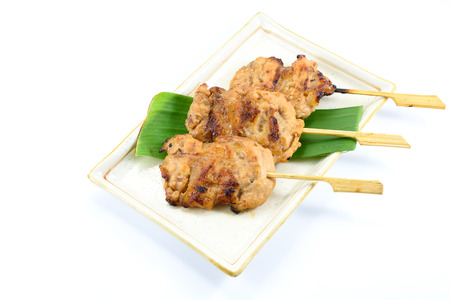 Thai styled pork barbeque (Grilled pork) isolated on white background, Thai local food Stock Photo