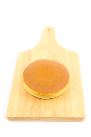 Dorayaki on a wooden board isolated on white background, Japanese dessert