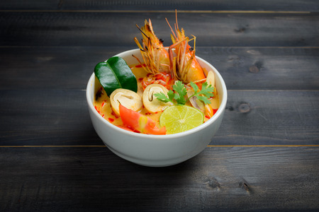Tom Yum Soup or River Prawn Spicy Sour Soup (Tom Yum Goong) on wooden table, Thai local food Stock Photo