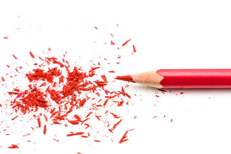 Colour pencill with sharpening shavings on white background Stock Photo