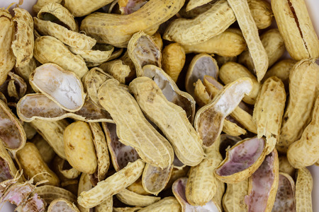 closeup detail and texture a bunch of Peanut shells Stock Photo