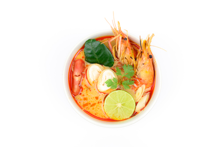 Tom Yum Soup or River Prawn Spicy Sour Soup (Tom Yum Goong) isolated on white background top view, Thai local food