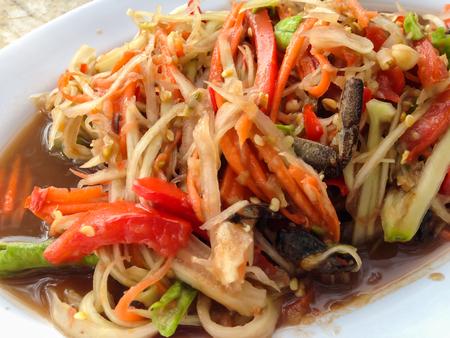 papaya salad with vegetable on a dish, Thai local food