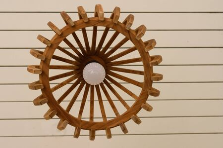 Wooden electronic lamp hanging from the ceiling
