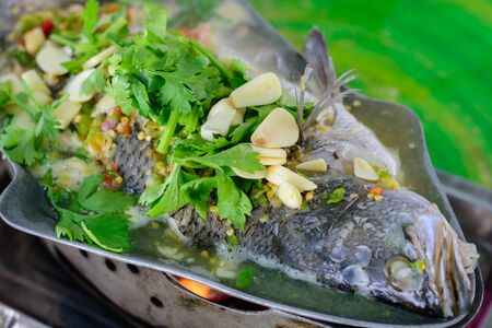 close up of Steamed Fish in Lemon Sauce, Thai local food