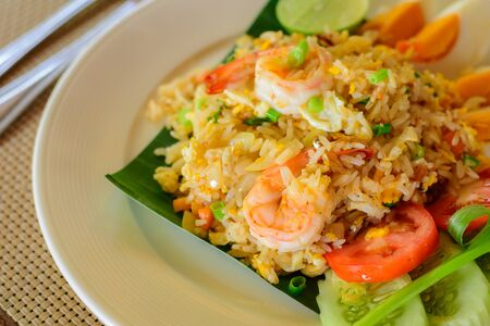 Fried rice with shrimp and salted eggs slice on a plate. Thai local food