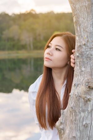 Portrait asian woman feelling freshness and relaxing in the forest