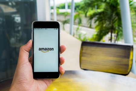 amazon com: CHIANG MAI, THAILAND - JULY 29, 2016: Amazon.com, Inc. is an American international electronic commerce company. It is the worlds largest online retailer. Site went online as Amazon.com in 1995