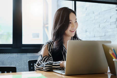 freelance concept,female using computers to design work as ordered by customers.
