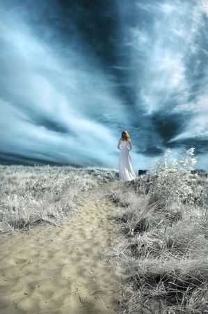 infrared: Woman in white gown on a beach path. Infrared.