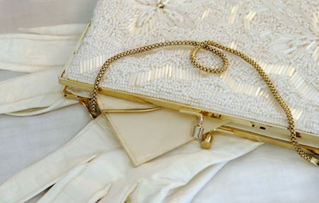 White beaded purse and gloves. Stock Photo