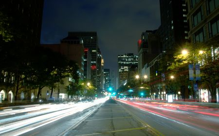 ave: Michigan Ave in downtown Chicago at night.