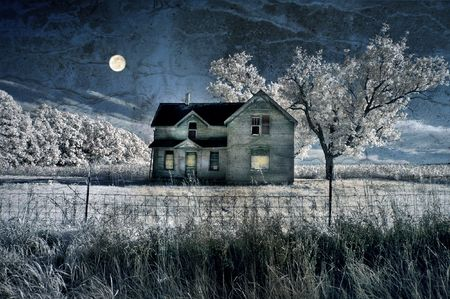 broken house: Haunted farmhouse under a full moon in infrared with grunge texture added. Stock Photo