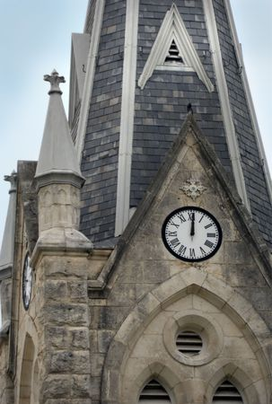 Clock in an old stone church steeple. Stock Photo - 2256161