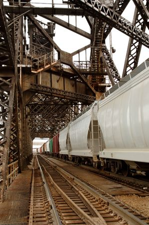 goods train: Cars of a long freight train on the tracks. Stock Photo