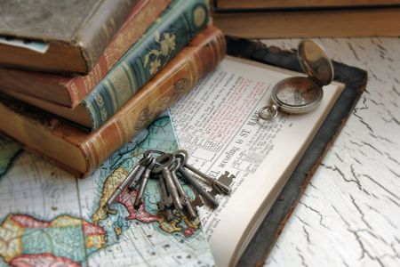 Antique Bible with keys and a map. photo