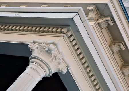 eaves: Arcitectural column and carved detail under the eaves.