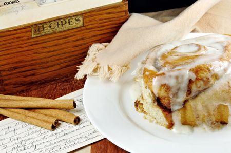 sugary: Cinnamon Roll with Recipe and cinnamon sticks.