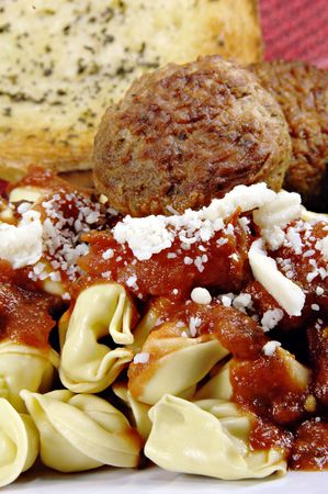 Tortellini and meatballs with sauce and bread. Stock Photo - 2550731