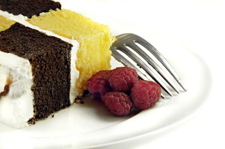 Checkerboard Cake with Raspberries on a white background.