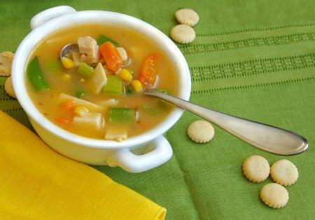 Chicken and vegetable soup with oyster crackers.