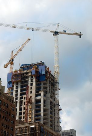 Skyscraper under construction with a crane. Stock Photo - 3200017