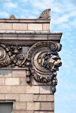 Architectural detail of a lion's head on the corner of a building. Stock Photo - 3403925