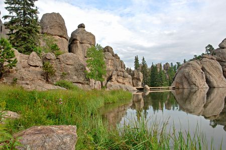 sylvan: Sylvan Lake in the Black Hills of South Dakota. Grass and wildflowers with reflections of the rocks.