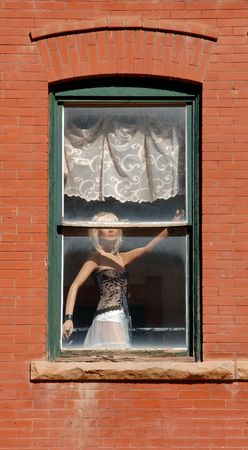prostitution: Mannequin in a window in Deadwood, South Dakota to depict the prostitution in its past. Stock Photo