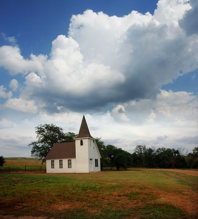 steeples: Small country church out on the prairie in South Dakota.