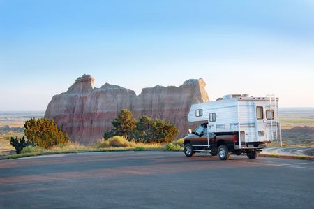 badlands: Recreational Vehicle in the Badlands National Park, South Dakota. Stock Photo