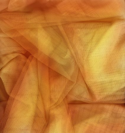 netting: Orange and gold netting fabric perfect for a background.