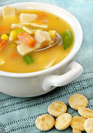 Home-made chicken vegetable and noodle soup with oyster crackers.