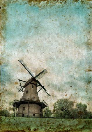 dutch: Windmill on a grunge background with copyspace for your own text.