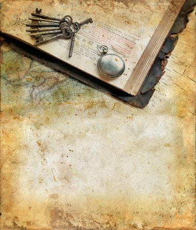 Vintage bible, keys, watch and map on a grunge background with copy-space for your text. Stock Photo
