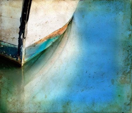Bow of an old boat reflecting in the water. Copy-space for your own text. photo