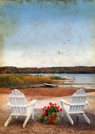 adirondack: Adirondack chairs by the water on a grunge background in the fall.