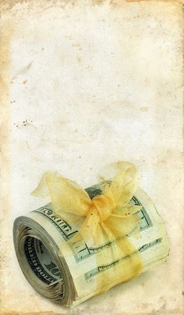 Money tied with gold ribbon on a grunge background. Stock Photo - 3871045
