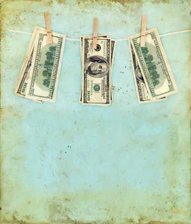 Money hanging on a clothesline with a grunge background. photo