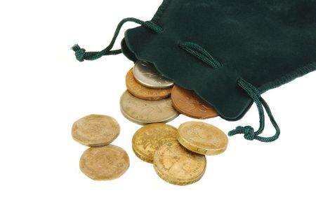 British coins spilling out of a small green purse on a white background.