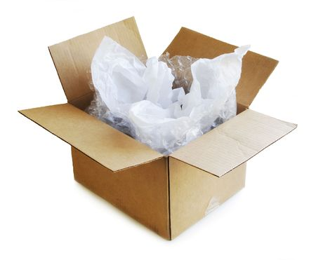 unpacked: Open cardboard box with tissue paper and bubble wrap.