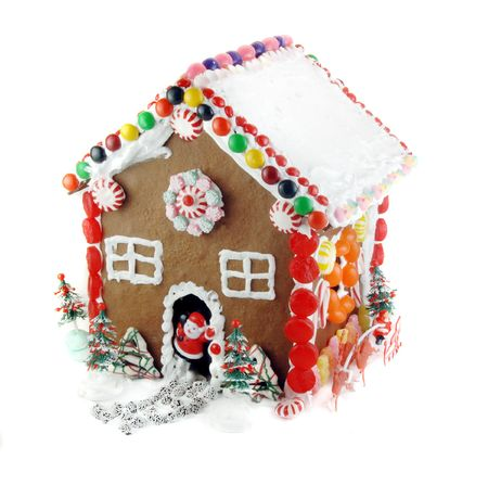 Gingerbread house decorated with candy and frosting for the Holidays. Stock Photo
