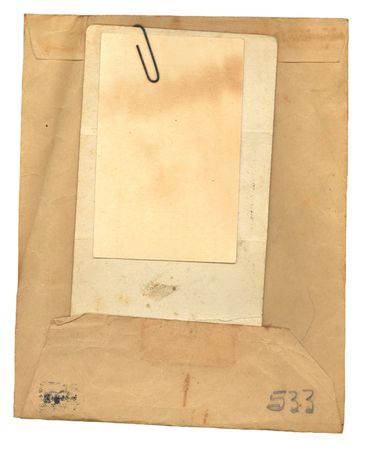 old envelope: Vintage stained, used, manila envelope and papers for a background.