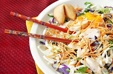 thai noodle: Asian chicken salad with chopsticks and a fortune cookie. Stock Photo