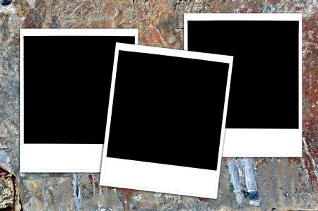gouged: Instant photos on a grungy painted wood surface, blank for your image or text.