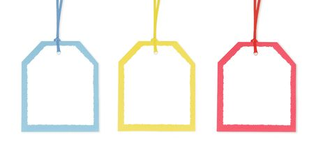 Three gift tags with red, blue, and yellow borders. photo